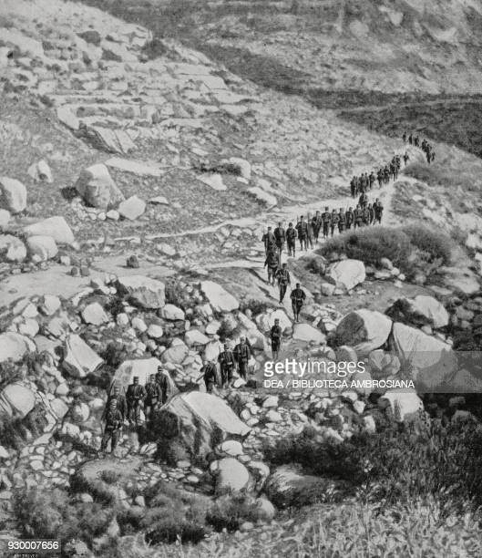 Soldiers of the 40th Infantry on the march to protect the works being done in the bed of the Uadi Derna Libya ItalianTurkish war photograph by...