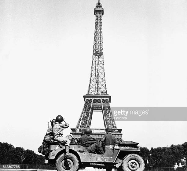 Soldiers of the 4th US Infantry Division drive by to see the Eiffel Tower in Paris just after the French capital's liberation from German occupation...