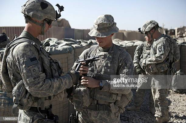 US soldiers of the 502nd Infantry regiment 2nd Batallion Charger company 1st platoon load their weapons before a patrol around Ahmed Khan camp near...