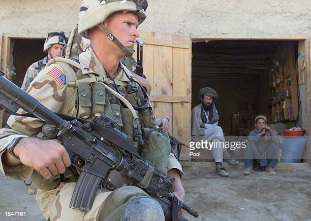 S soldiers of the 82nd Airborne Division secure an area near a small shop during inspection of a local bazaar November 14 2002 in the town of Yayeh...