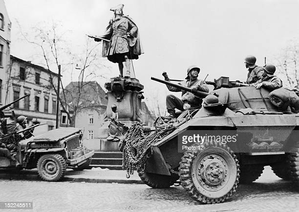 Soldiers of the 9th US Army inspect the statue of Frederick I of Prussia in the captured town of Moers Spring 1945
