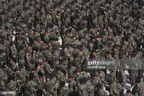 Soldiers of the Afghanistan National Army take an oath to defend their country during a midcourse ceremony at the Kabul Military Training Center...