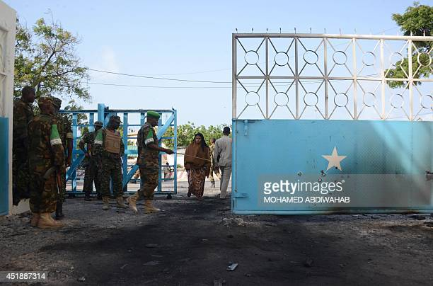 Soldiers of the African Union stand by the main gate riddled with bullets of the presidential palace in Mogadishu on July 9 2014 following an attack...