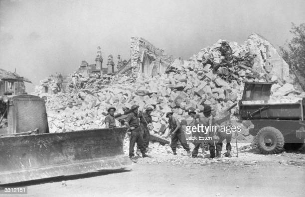 Soldiers of the Allied Army clearing up the wreckage in Caen France