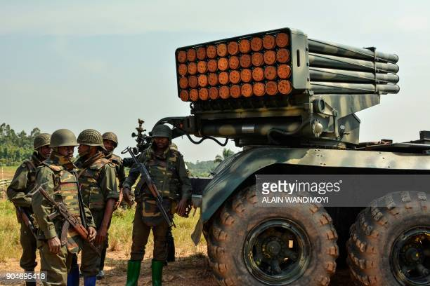 Soldiers of the Armed Forces of the Democratic Republic of the Congo stand near a mobile multiple rocket launcher in Matombo 35km north of Beni North...