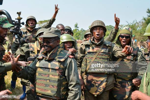 Soldiers of the Armed Forces of the Democratic Republic of the Congo celebrate next to a commanding officer in Matombo 35km north of Beni North Kivu...