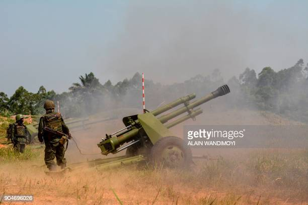 Soldiers of the Armed Forces of the Democratic Republic of the Congo fire a mobile artillery piece in Matombo 35km north of Beni North Kivu on...