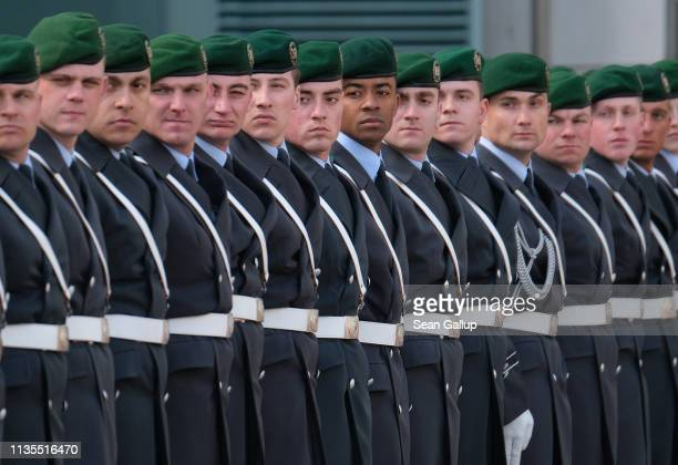Soldiers of the Bundeswehr arrive for the state visit of a foreign leader at the Chancellery on March 13 2019 in Berlin Germany The German government...