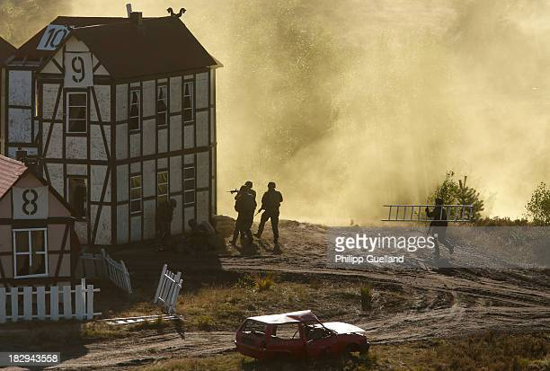 Soldiers of the Bundeswehr prepare to clear a house during the annual military exercises held for the media at the Bergen military training grounds...