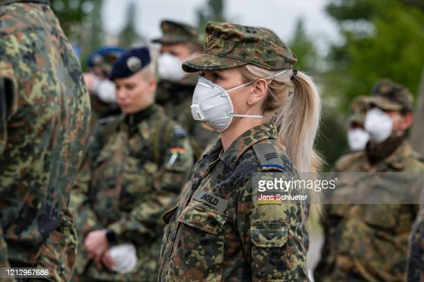 Soldiers of the Bundeswehr the German armed forces are preparing to test workers for possible Covid19 infections of the Toennies slaughterhouse and...