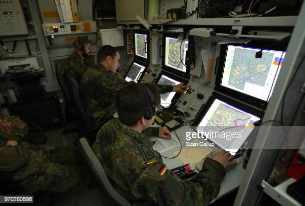 Soldiers of the Bundeswehr the German armed forces look at footage and data they are receiving live from a KZO reconaissance drone during Thunder...