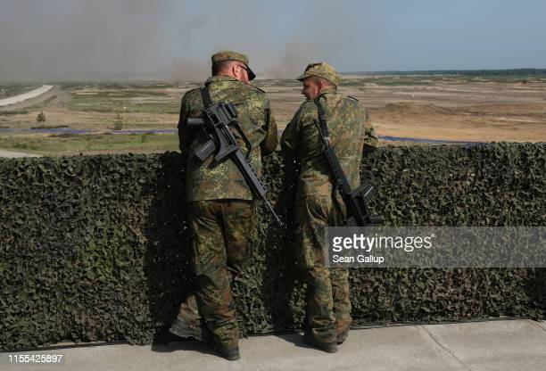 Soldiers of the Bundeswehr the German armed forces prepare to watch a live fire demonstration during the NATO Noble Jump military exercises on June...