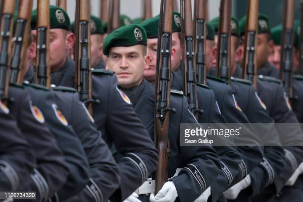 Soldiers of the Bundeswehr the German armed forces take part in an honor guard ceremony for a state visit at the Chancellery on February 1 2019 in...