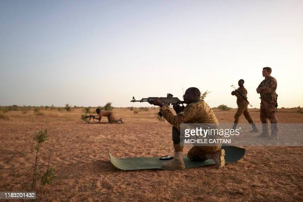 Soldiers of the Burkina Faso Army take part in shooting exercises during a joint operation with the French Army in the Soum region in northern...