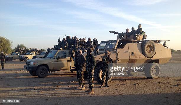 Soldiers of the Chadian army stand on January 21 at the border between Nigeria and Cameroon some 40 km from Maltam as part of a military contingent...