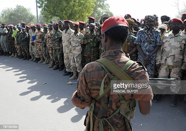 Soldiers of the Chadian national army attend on February 13 2008 in N'Djamena the funeral of Chad army's chief of staff General Daoud Soumain killed...