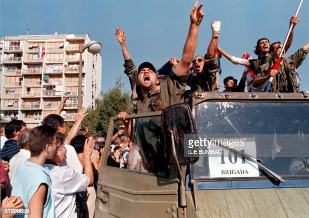 Soldiers of the Croatian Army 101st Brigade sing and shout slogans as they are greeted by residents and relatives in Susedgrad a western suburb of...