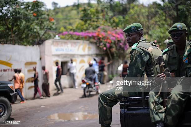 Soldiers of the Democratic Republic of Congo Armed Forces wait outside a general's residence in Goma on April 11, 2012 during a meeting called by the...