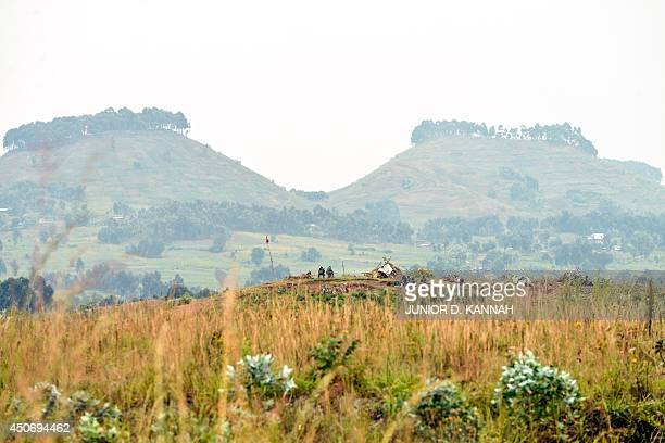 Soldiers of the Democratic Republic of Congo keep watch on the Rwandan border at a position some 20 kilometres north of the border town of Goma on...