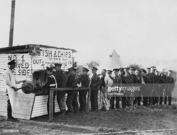 Soldiers of the Duke of Wellington's Regiment line up for Fish and Chips from a mobile shop set up in the Wathgill Camp during Territorial manoeuvers...