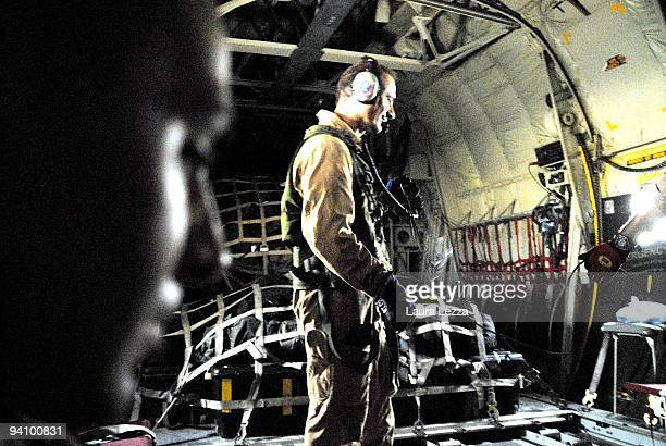 Soldiers of the Folgore Parachute Brigade and Italian Air Force pilots of the 46th Brigata Aerea Pisa on a C 130 airplane leave Camp Arena military...