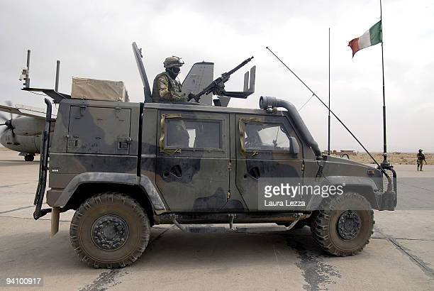 Soldiers of the Folgore Parachute Brigade on a Lince vehicle patrolling the airport's military base of Camp Thomas on September 16 2009 in Shindand...