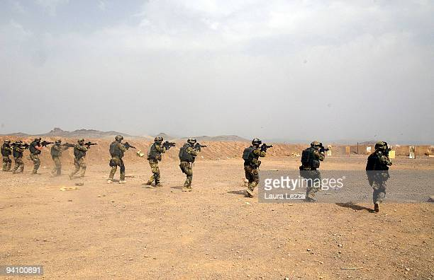 Soldiers of the Folgore Parachute Brigade prepare before an excercise in the military shooting centre on September 17 2009 in Shindand Afghanistan...