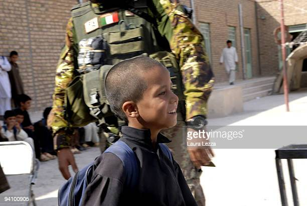 Soldiers of the Folgore Parachute Brigade visit a children school on September 16 2009 in Shindand Afghanistan During these operations soldiers...