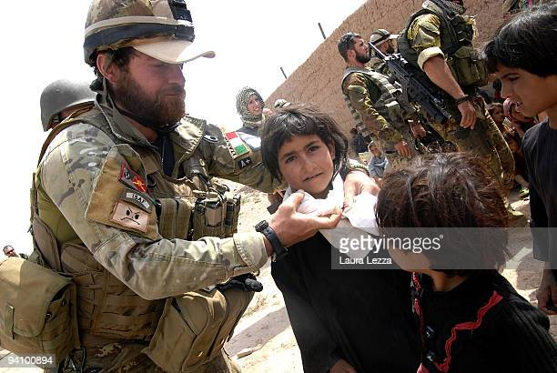 Soldiers of the Folgore Parachute Brigade visit a childrens school on September 16 2009 in Shindand Afghanistan During these operations soldiers...