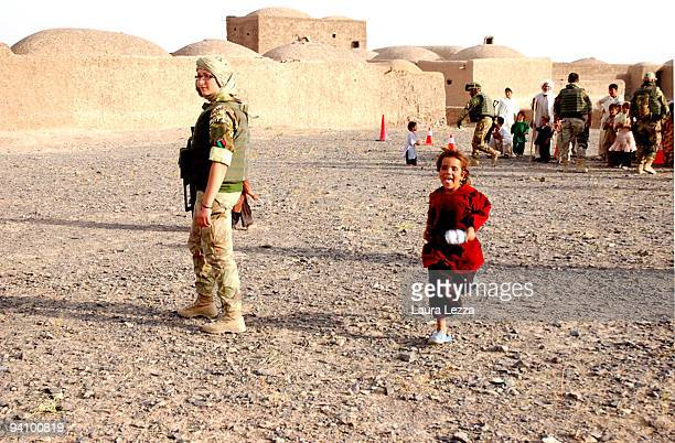 Soldiers of the Folgore Parachute Brigade visit a small and remote village on September 16 2009 off the city of Shindand Afghanistan During these...