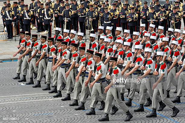 Soldiers of the Foreign Legion march down the Champs Elysees during the annual Bastille Day military parade on July 14 in Paris France Bastille Day...