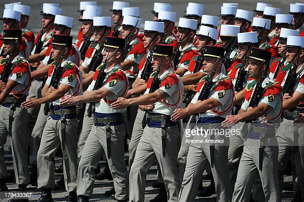 Soldiers of the Foreign Legion parade march during the Bastille Day parade on the Champs Elysees on July 14 2013 in Paris France The annual military...