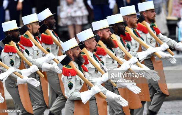 Soldiers of the Foreign Legion regiment march during the annual Bastille Day military parade in Paris France on July 14 2019