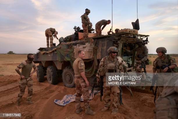 Soldiers of the French Army get out of the Armoured Personnel Carrier used to patrol the Soum region during the Bourgou IV operation in northern...