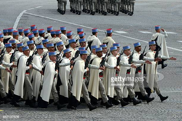 Soldiers of the French Foreign Legion march down the ChampsElysees during the annual Bastille Day military parade on July 14 2014 in Paris France...