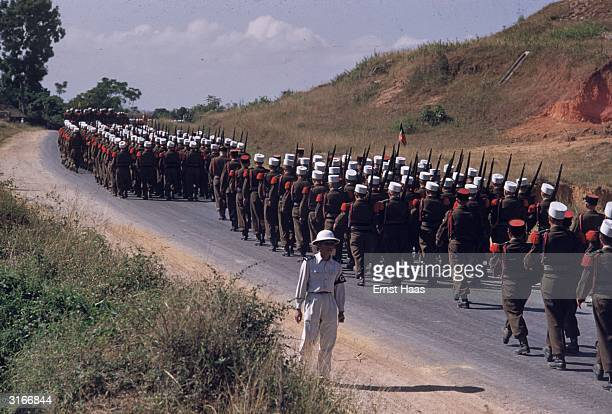 Soldiers of the French Foreign Legion parade through Bao Ninh in the former Indochina