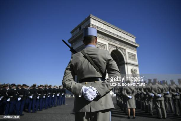 TOPSHOT Soldiers of the French Foreign Legion stand before the beginning of the ceremony marking the 73rd anniversary of the victory over Nazi...