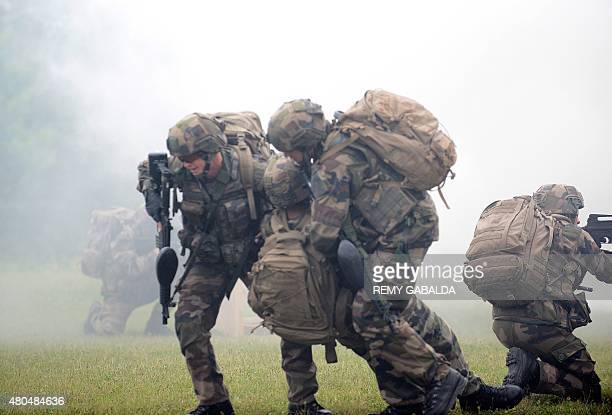 Soldiers of the French Foreign Legion take part in a drill at The Farm a training center near Castelnaudary southwestern france on June 16 2015 AFP...
