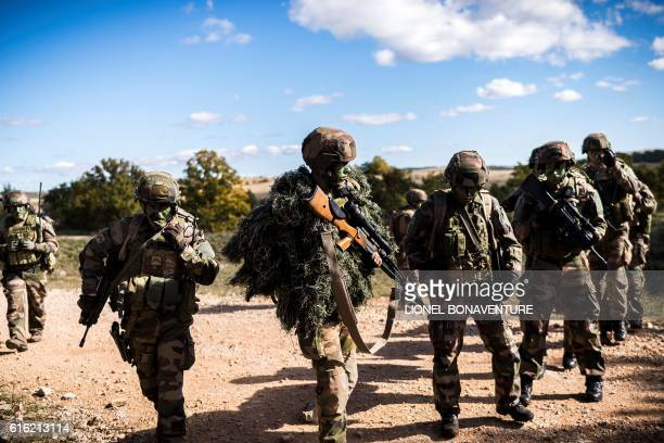 Soldiers of the French Foreign Legion's 13th DemiBrigade are pictured during an exercice in its future military camp Camp du Larzac in La Cavalerie...