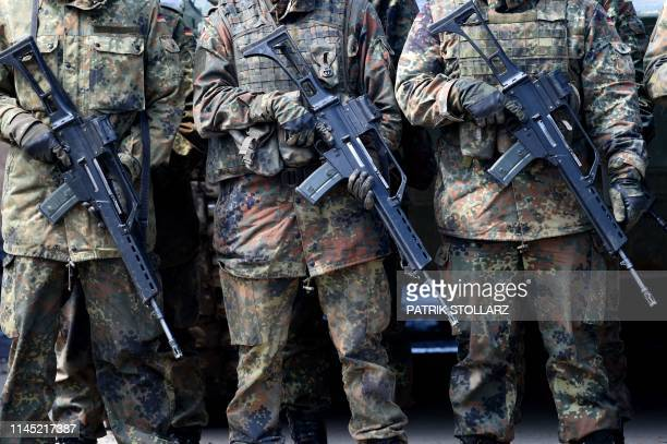 Soldiers of the German armed forces Bundeswehr hold HK G36 rifles during an informative educational practice of the Very High Readiness Joint Task...