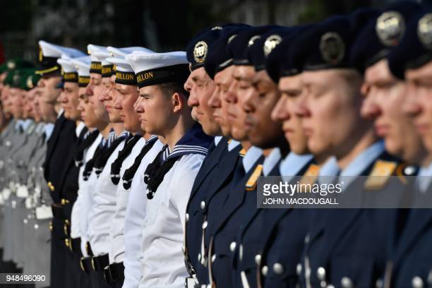 Soldiers of the German Armed Forces Bundeswehr perform military honors for the German Defence Minister and the incoming Bundeswehr Inspector General...