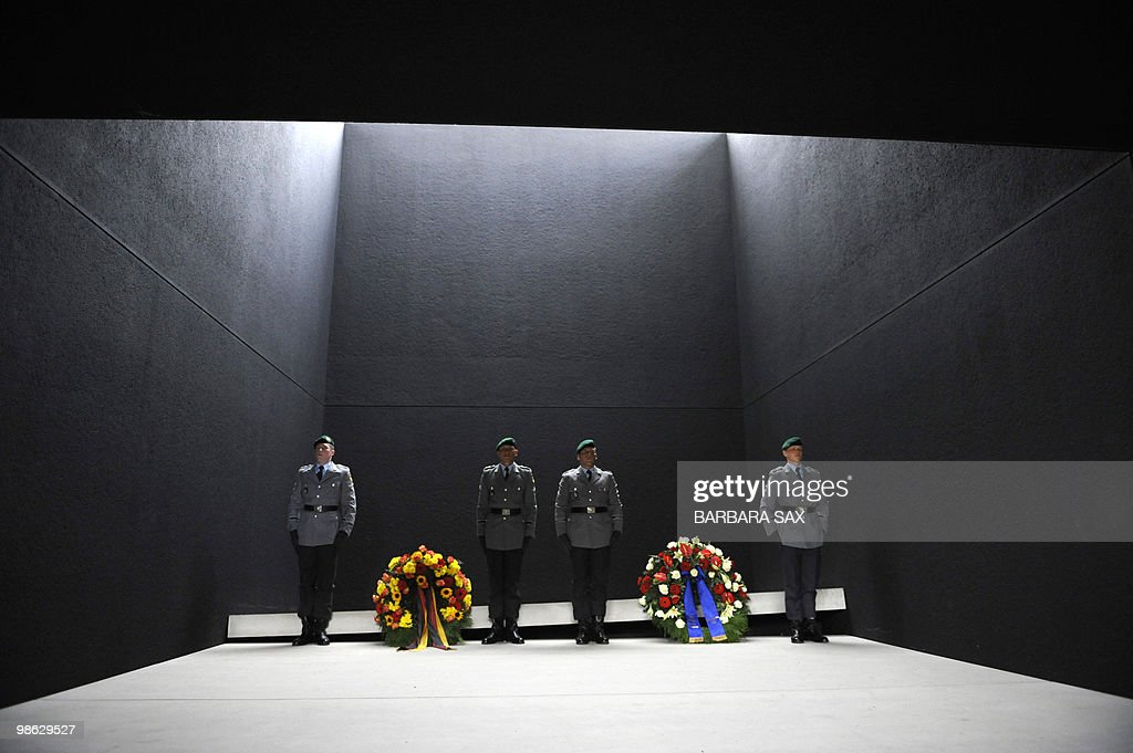 Soldiers of the German armed forces Bundeswehr stand guard next to wreathes laid down for killed comrades by the commander of US and NATO troops in Afghanistan, General Stanley McChrystal, and German Defence Minister Karl-Theodor zu Guttenberg (both not in picture) on April 21, 2010 at the Bundeswehr memorial in Berlin. McChrystal had postponed his visit twice, due to disruptions from the volcanic ash cloud. According to press reports, McChrystal wanted to see Berlin commit to making 'an important contribution' to a planned US-led offensive against Taliban forces later this year in northern Afghanistan, where Germany's troops are based.