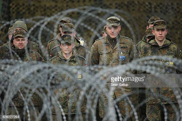 Soldiers of the German Armed Forces the Bundeswehr stand in formation during the visit of Polish President Andrzej Duda and German President Joachim...
