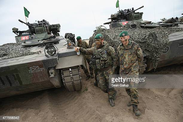 Soldiers of the German armed forces the Bundeswehr stand next to their Marder light tanks during the NATO Noble Jump military exercises of the VJTF...