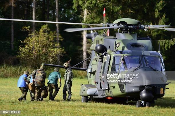 Soldiers of the German Armed Forces the Bundeswehr transport an injured soldier to an Airbus NH90 TTH of the Bundeswehr during a threeday Bundeswehr...