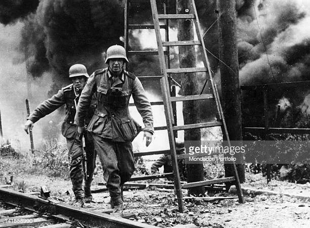 Soldiers of the German army walking along the tracks after attacking a Soviet fort in the Latvian capital. Riga, June 1941