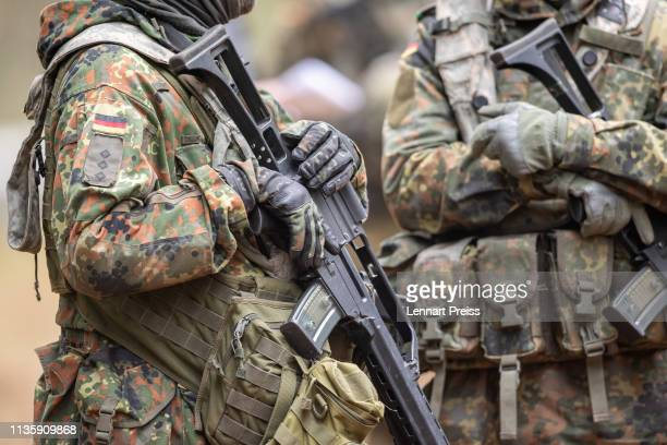 Soldiers of the German Bundeswehr hold their G36 rifles during the Allied Spirit X international military exercises at the US 7th Army training...