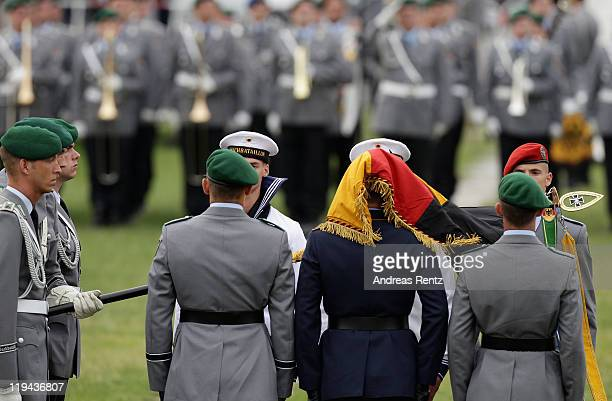 Soldiers of the German Bundeswehr stand at attention at a swearingin ceremony for new recruits in front of the Reichstag on July 20 2011 in Berlin...