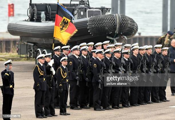 Soldiers of the German Navy stand in front of a rubber dinghy of the combat swimmers during a roll call in Eckernfoerde Germany 01 April 2014 The...