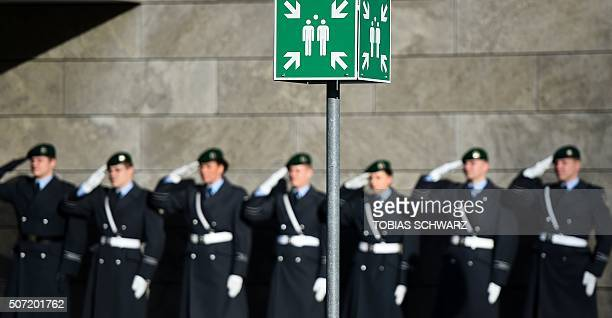 Soldiers of the guard of honour of the German armed forces Bundeswehr salute during a welcome ceremony hosted by German Defence Minister Ursula von...
